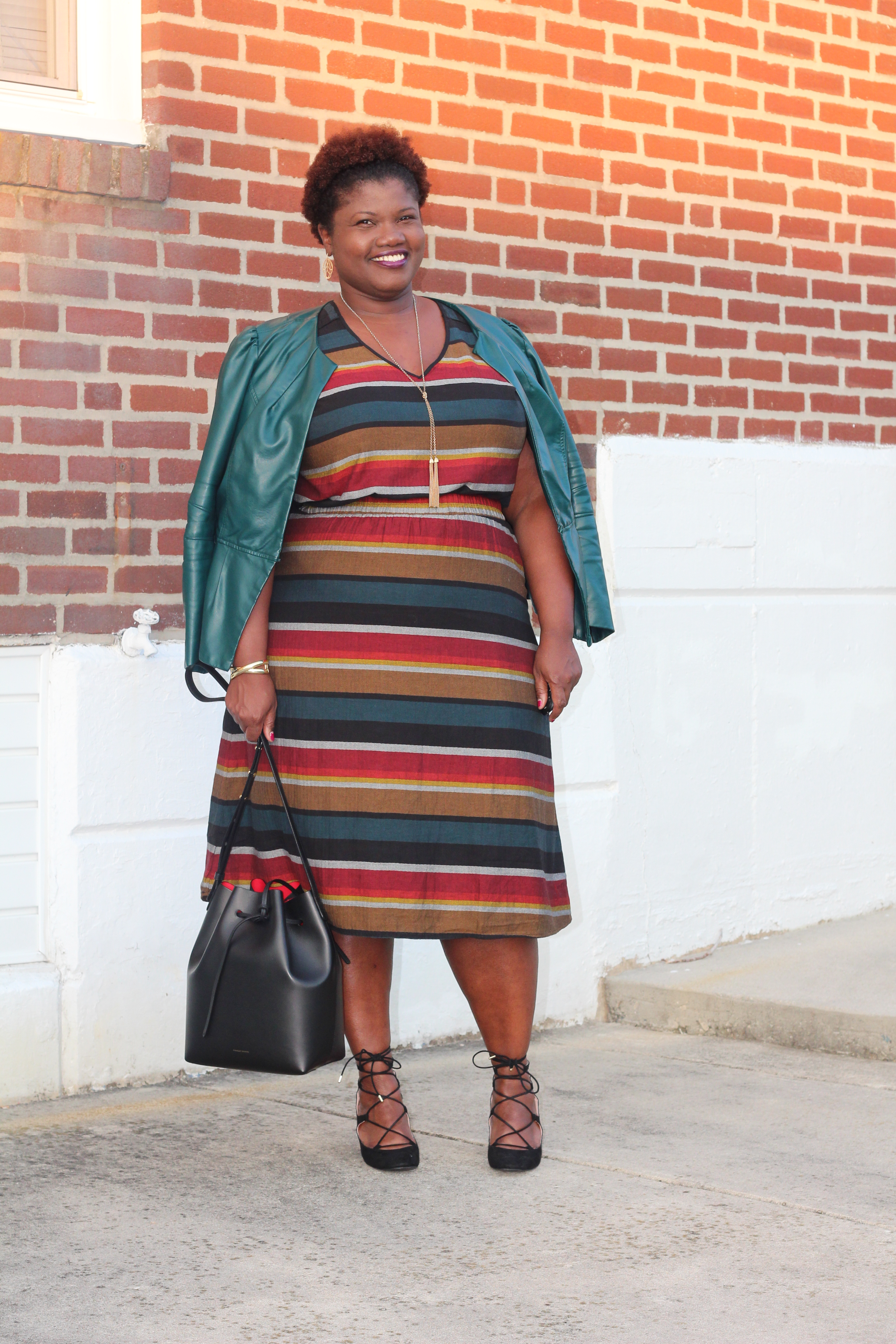curvy women, curvy, curvy girls, stripes, fall colors, fall, midi skirts, stripe midi skirts, midi skirts for plus size women, plus size midi skirts, faux leather, lace up heels, mansur graviel, bucket bags, natural hair, plus size fashion, plus size fashion blog, plus size fashion bloggers, grown and curvy woman blog, grown and curvy, black plus size bloggers, bloggers over 40, 40+ blogs, 40+ bloggers, blogs for women over 40