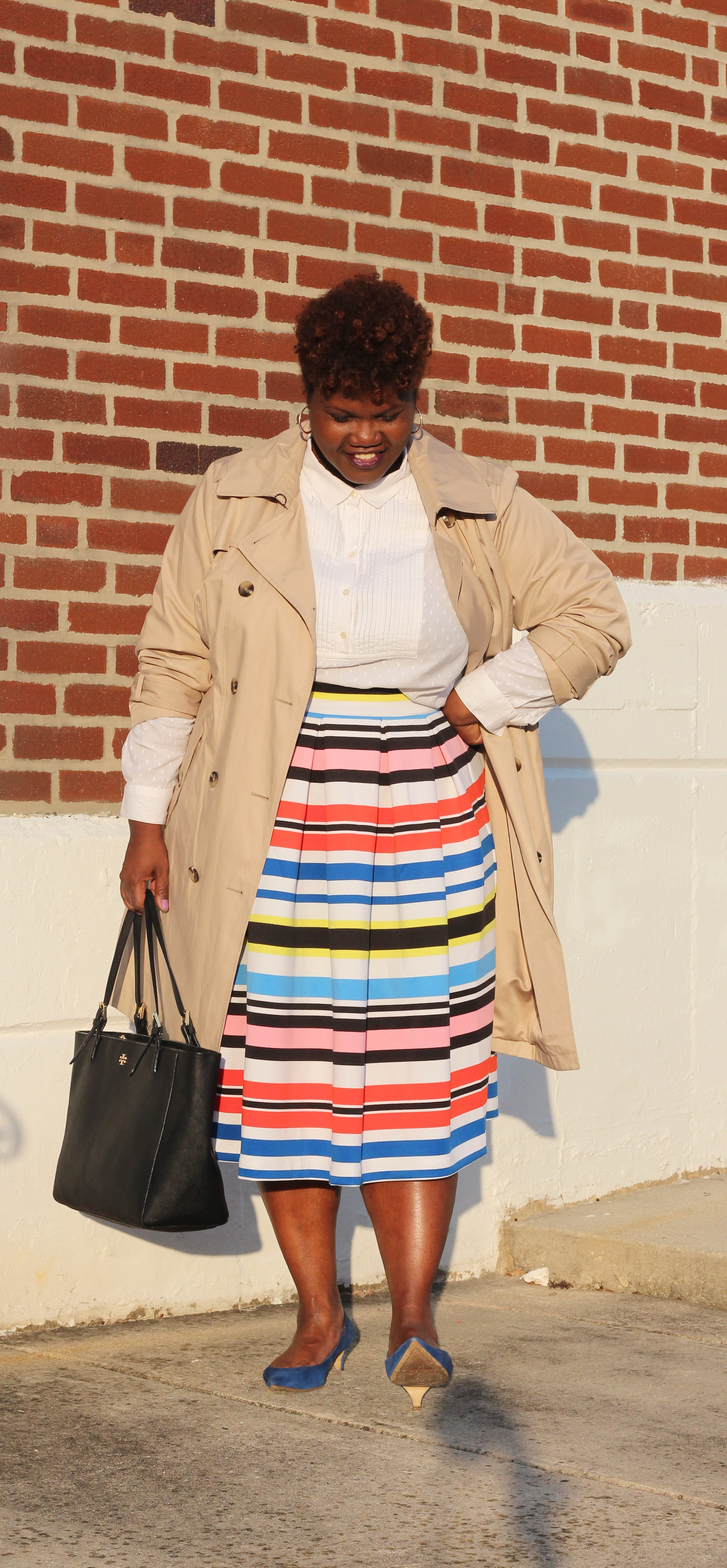 plus size blogger, plus size blogs, trench coat, spring fashion, midi skirts, plus size midi skirt, stripe skirt, multicolor stripe skirt, collared shirts, button up shirt, natural hair, curvy women, curvy girls, curvy woman, curvy bloggers, curvy blogs, tory burch, satchel, suede shoes, mid heels, kitten heels, nine west, blogs for women over 40, over 40 blogs, over 40 fashion blogs, over 40 plus size blogs